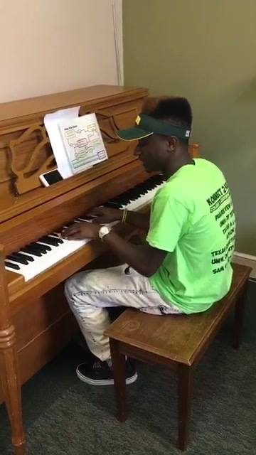 One of our talented students playing the piano and we waited to tour a dorm room