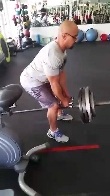 Knees bent, big chest, and maintain natural arch of spine. I see too many fitness pros, and figures sacrifice form for w...